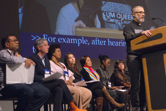 The Rev. Alex da Silva Souto, a delegate to the 2019 United Methodist General Conference, addresses the special session of the New York Annual Conference where delegates shared their reflections on what happened in St. Louis. From left are: Jorge Lockward, the Revs. Kristina Hansen, Sheila Beckford and Vicki Flippin, Karen Prudente, Tiffany French Goffe and the Rev. Martha Vink. Photo by Stephanie Parsons.