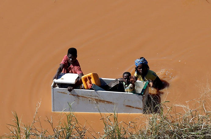 A child is transported inside an empty refrigerator during floods after Cyclone Idai, in Buzi, outside Beira, Mozambique. The United Methodist Committee on Relief has allocated three $10,000 grants for immediate, emergency short-term funding to meet basic human needs of those affected in Mozambique, Zimbabwe and Malawi. Photo by Siphiwe Sibeko, REUTERS