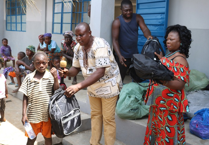 A new student at The United Methodist Church Primary School in Sayllu, Sierra Leone, receives a backpack, uniform, shoes, books and other learning materials in preparation for the start of the 2019 school year. Photo by Phileas Jusu, UMNS.