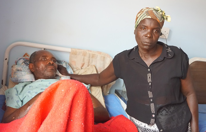 Cyclone Idai survivor Geshem Makufa, 55, is being treated at United Methodist Mutambara Mission Hospital in the Chimanimani District of Eastern Zimbabwe. He is pictured with his wife, Tandiwe Makufa. Photo by Kudzai Chingwe, UMNS.