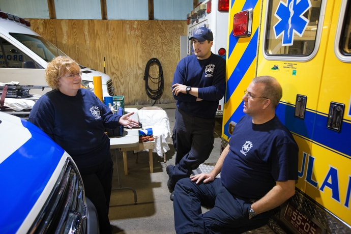 EMT Deb Dague (left) visits with EMT Ryan Seidewitz (center) and paramedic Jeff Luck at the Brooke County EMS station in Wellsburg, W.Va. Photo by Mike DuBose, UMNS.