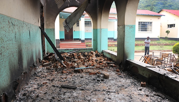 Debris blocks pathways around Hartzell High School, a United Methodist school at Old Mutare Mission in Mutare, Zimbabwe. Desks saved from the fire are piled outside the walls. Photo by Priscilla Muzerengwa, UMNS.