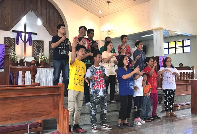 A United Methodist deaf choir signs the words of a hymn during worship in the Baguio Area in northern Philippines. Across the country, an assessment team saw evidence of church vitality. Photo courtesy of the Standing Committee on Central Conference Matters.