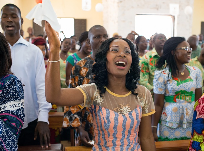Claudia Teli N'guessan sings during worship at Temple Emmanuel United Methodist Church in Man, Côte d'Ivoire, in this 2015 file photo. Photo by Mike DuBose, UMNS.