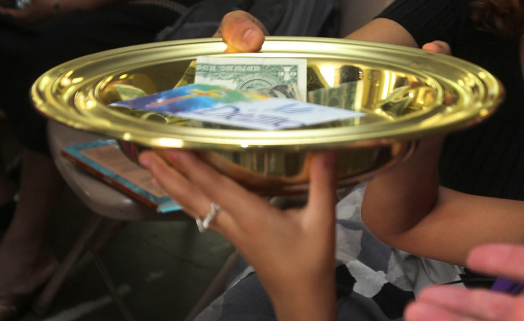 While some plan to withhold church giving, the Desert Southwest Conference asks its churches to continue funding ministry at the conference and global level. Photo illustration by Kathleen Barry, UMNS.