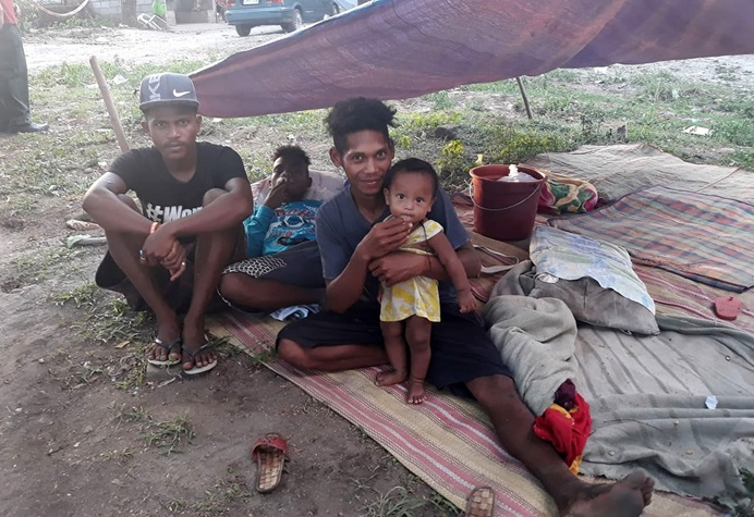 A family spends the night in a makeshift tent in Porac, Philippines, after a powerful earthquake struck the main island of Luzon on Monday. Photo by Rommuel S. Flores.