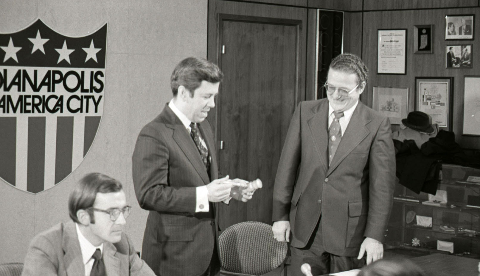 In 1975, then Indianapolis Mayor Richard Lugar presents a ceremonial gavel to University of Indianapolis president Gene E. Sease. Photo courtesy of the University of Indianapolis.