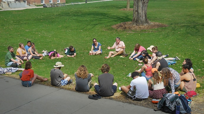 Professor Laird Christensen leads a class outside during the SLATE seminar, an introductory course for first-year students, at Green Mountain College in Poultney, Vt. Photo courtesy of Green Mountain College.