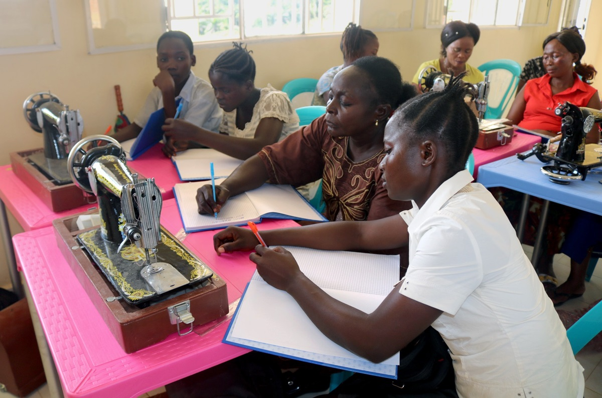 Bibiche Ohanga, right, learns to sew at the Mama Lynn Center, a United Methodist sanctuary for sexual violence survivors in Kindu, Congo. Ohanga received a scholarship from The United Methodist Church to attend the Higher Institute of Nursing Sciences in Kindu. Photo by Judith Osongo Yanga, UMNS.