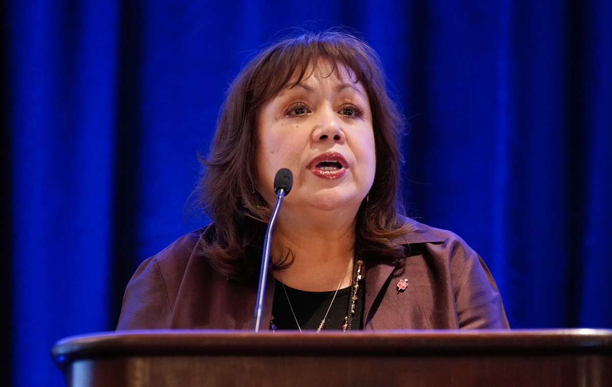 Bishop Minerva Carcaño speaks to her fellow episcopal leaders about the work of the Immigration Task Force during the Council of Bishops meeting near Chicago. Photo by the Rev. Todd Rossnagel, Louisiana Conference.