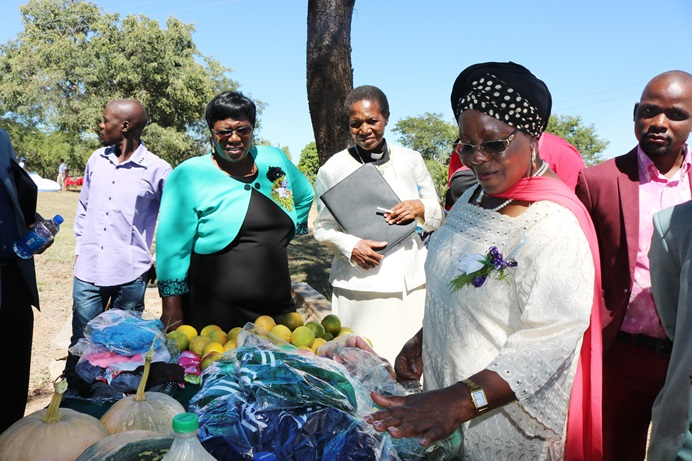 Sithembiso Nyoni, Zimbabwe's Women and Youth Affairs minister, visits a booth at a recent economic expo hosted by The United Methodist Church in Marange, Zimbabwe. Nyoni was the guest of honor at the event, which aimed to offer business opportunities to people living in rural communities. Photo by Priscilla Muzerengwa, UMNS.
