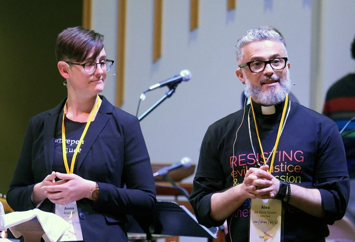 The Revs. Anna Blaedel and Alex da Silva Souto officiate at a communion service concluding the Our Movement Forward conference. The event was geared toward starting a new Methodist movement centered on the voices of people of color and LGBTQ individuals. Photo by Heather Hahn, UM News.