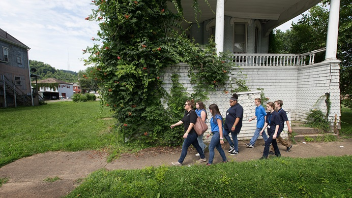 Kate Rhodes (left) leads students from House of the Carpenter back from a field trip on Wheeling Island in Wheeling, W.Va. Rhodes was serving as youth coordinator for the program's Pre-Work Camp, which teaches basic employment skills to middle school students. House of the Carpenter is a mission project of The United Methodist Church's West Virginia Conference.