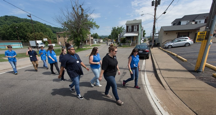 Kate Rhodes (right, foreground) leads students from House of the Carpenter back from a field trip on Wheeling Island. Photo by Mike DuBose, UM News.