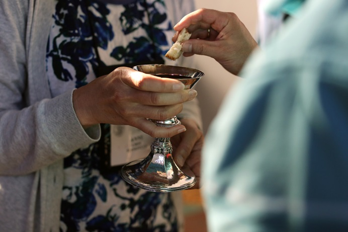 Eucharist is shared during the morning prayer held in the chapel of Sarum College during the 2016 Wesley Pilgrimage in England. Photo by Kathleen Barry, United Methodist Communications.