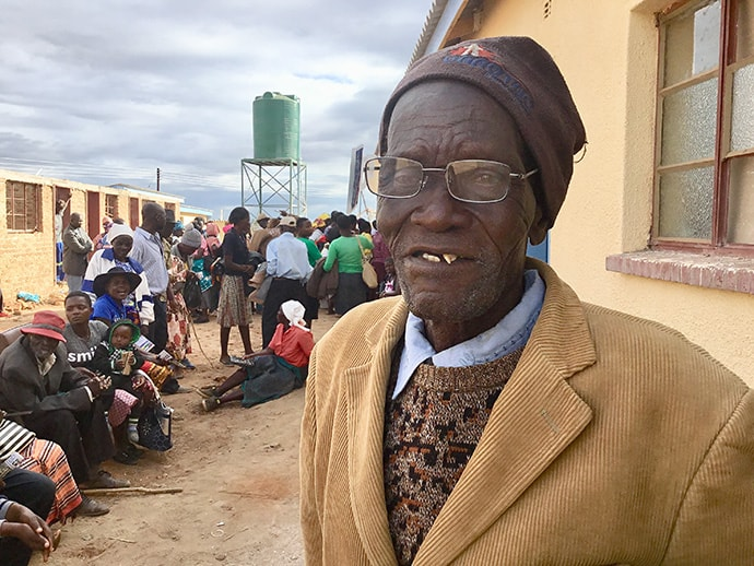 Kwedze Nyabani tries the new glasses he received during an outreach program at the Dindi United Methodist Clinic in Zimbabwe. Photo by the Rev. Taurai Emmanuel Maforo, UM News.