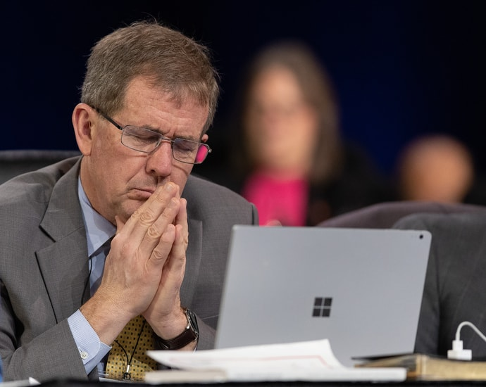 Bishop Scott Jones prays during the 2019 United Methodist General Conference in St. Louis. He and Bishop David Bard have recently offered a plan that would dramatically reorganize The United Methodist Church. File photo by Mike DuBose, UM News.