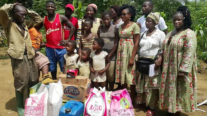 The United Methodist Women Association of Cameroon has donated food and household items to internally displaced people, mostly women and children, who are living in the bushes in the southwest region of the country. Photo by Collette Ndobe, UM News.