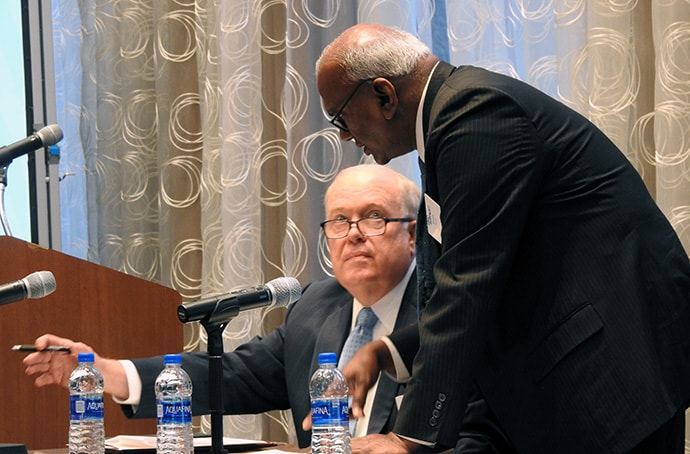 Bishop Michael McKee, president of the General Council on Finance and Administration, confers with Moses Kumar, GCFA's top executive, on July 19 in Dallas. GCFA's board heard that giving across the church is down since the 2019 General Conference in February. Photo by Sam Hodges, UM News.