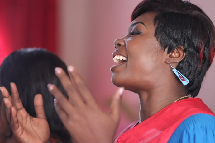 Sarah Ambadiang sings during worship at Blessing United Methodist Church, where she serves as a lay preacher and parish secretary. She is national president of the Cameroon United Methodist Women's Association. Photo by Isaac Broune, UM News.