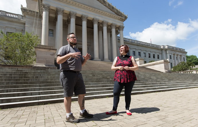 The Revs. Darick Biondi (left) and Cindy Briggs-Biondi are among faith leaders in West Virginia who say the church is called to advocate for mercy and justice. They are standing outside the West Virginia State Capitol in Charleston. Photo by Mike DuBose, UM News.