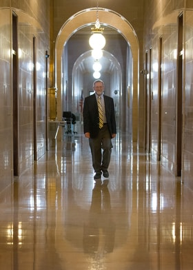 The Rev. Jeff Allen walks through the West Virginia State Capitol in Charleston, where he frequently testifies at hearings in his role as executive director of the West Virginia Council of Churches. One of the big issues Allen and the council have taken up is criminal justice reform relating to opioid addiction. Photo by Mike DuBose, UM News.
