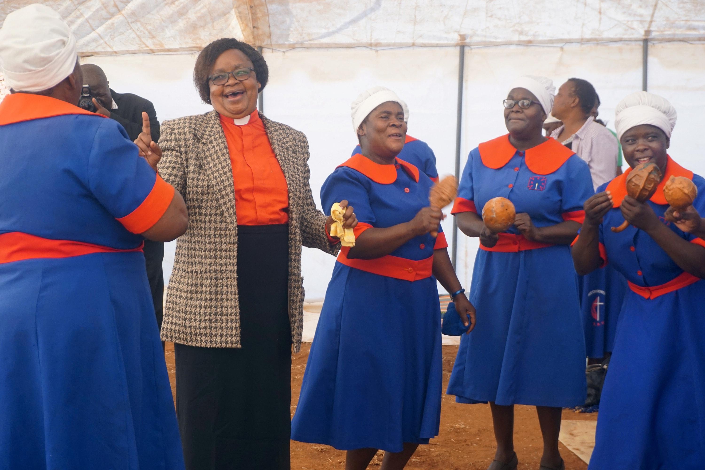 The Rev. Vienna Mutezo (in clerical collar) celebrates an evangelism crusade with United Methodist women in Chiredzi Town, Zimbabwe. Photo by Kudzai Chingwe, UM News.