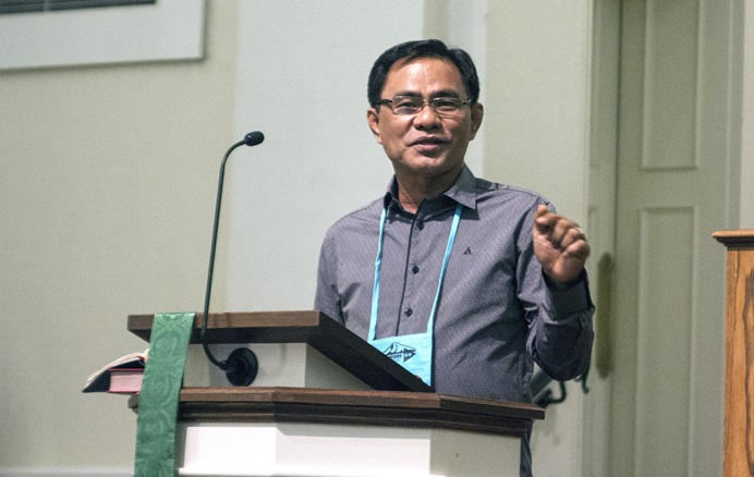 "Bishop Rodolfo Alfonso ""Rudy"" Juan, who leads the Davao Area in the southern Philippines, preaches at the Commission on General Conference meeting in Lexington, Ky. Juan expressed disappointment in the decision not to hold the 2024 General Conference in the Philippines. Photo by Heather Hahn, UM News."