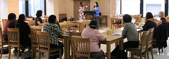 The Revs. Beauty Maenzanise (left) and HiRho Park explain the agenda to the participants of African and Asian Women Theologians Conference held Aug. 12-15 in Seoul, Korea. Photo by the Rev. Thomas Kim, UM News.