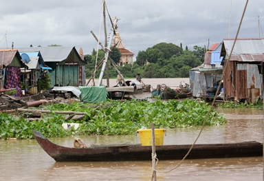 Villagers travel by boat to their home in a floating village on the Tonle Sap River near Phnom Penh, Cambodia. A United Methodist team visited the area to explore ways the church can help fight human trafficking. Photo by the Rev. Thomas Kim, UM News.