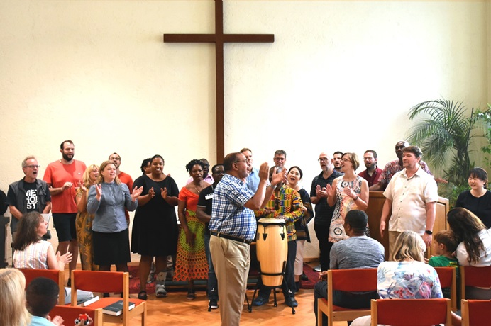 Participants sing during worship at a United Methodist Board of Global Ministries' pilot project aimed at providing training for pastors and laity who are leading congregations impacted by migration. The session was held Aug. 22-30 at The United Methodist Church of Germany Educational and Training Center in Stuttgart, Germany. Photo by Üllas Tankler, Board of Global Ministries.