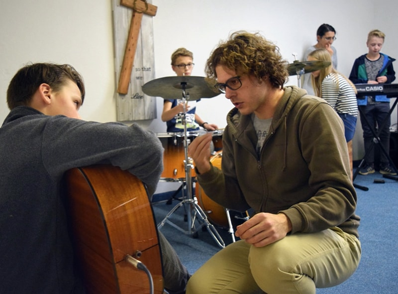 In addition to leading church services in Dolný Kubín, Slovakia, the Rev. Patrik Hipp along with his wife, Zuzana Hipp, and helpers established the FUSION Music Ministry, a group of young people (pictured) who meet to make music together. Photo courtesy of Rev. Patrik Hipp.