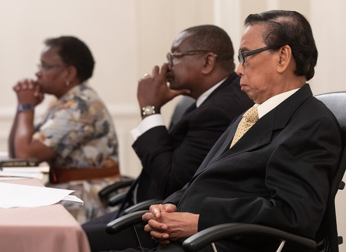 Members of the United Methodist Judicial Council listen during an oral hearing at their meeting in Evanston, Ill. From left are: the Rev. J. Kabamba Kiboko, N. Oswald Tweh Sr. and Ruben T. Reyes. Photo by Mike DuBose, UM News.