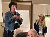 The Rev. Nicole Reilley (left), pastor of Valencia United Methodist Church and the Rev. Melissa MacKinnon, East District superintendent of California-Pacific Conference, speak to participants at the Fresh United Methodism Summit about the Saugus School shooting on Nov. 14. Photo courtesy of the California-Pacific Conference.
