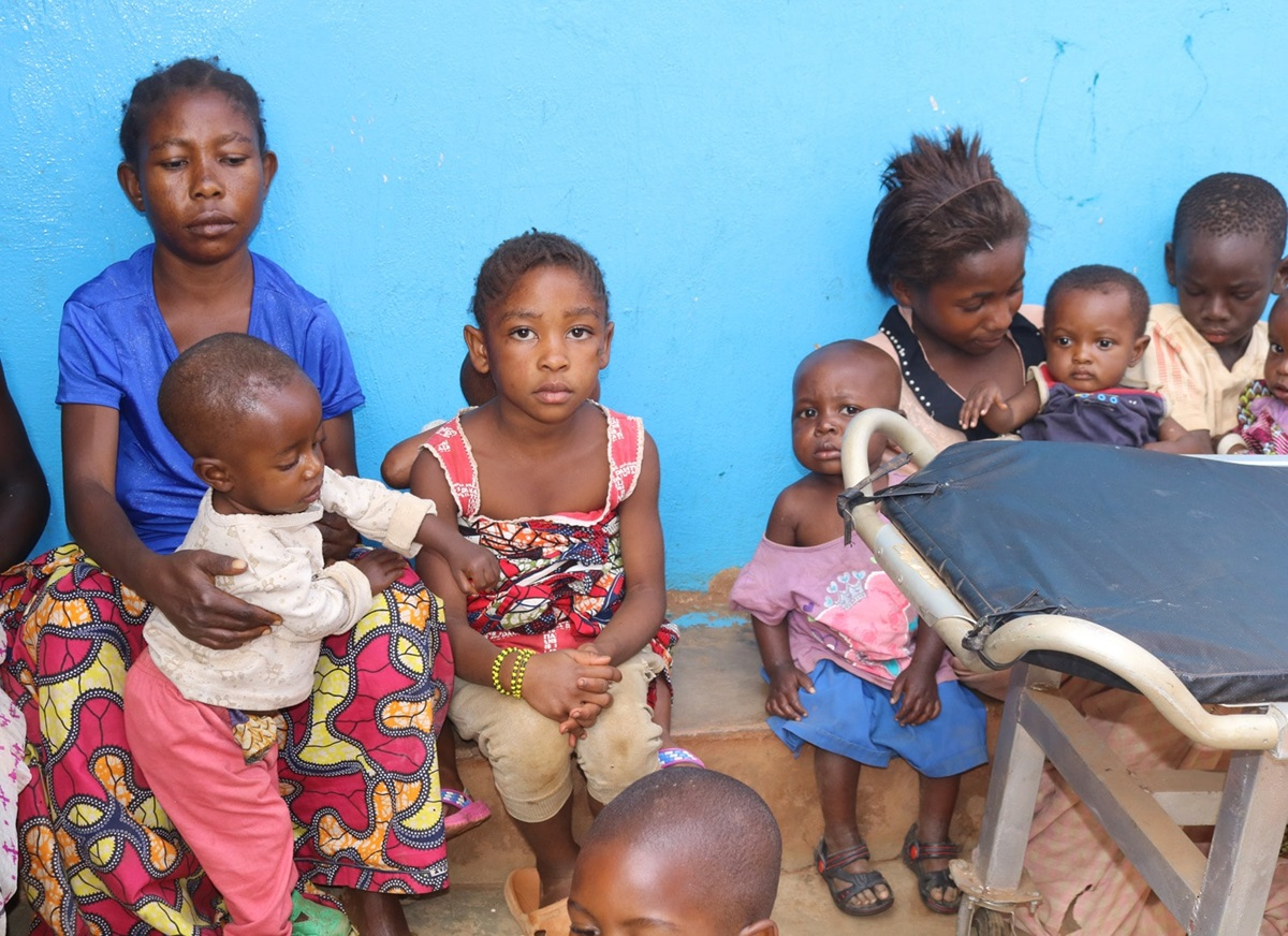 "Solange Cabwene (in blue shirt), a mother of two, brought her children to the United Methodist Irambo Health Center in Bukavu, Congo, for treatment for malnutrition. She joined The United Methodist Church's Vulnerable Association of Savings and Credit to help pay for her medical bills. ""This helped me because the association gave me a credit (loan) and today I start selling embers, and my two children (will) not relapse,"" she said. Photo by Philippe Kituka Lolonga, UM News."