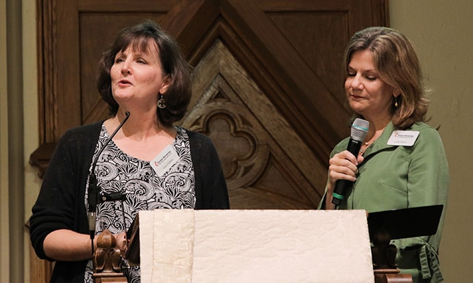 Karen Distefano, left, mission interpreter for the Encounter with Christ fund, and the Rev. Cynthia Weems, who heads the fund's advisory committee, speak about the fund's history and accomplishments during the Oct. 10 opening worship of the Global Ministries' board of directors fall meeting in Atlanta. Photo by Anthony Trueheart, Global Ministries.