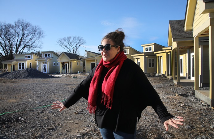 The Rev. Ingrid McIntyre shares the story of the micro house community for homeless respite care under construction at Glencliff United Methodist Church in Nashville, Tenn. Photo by Kathleen Barry, UM News.