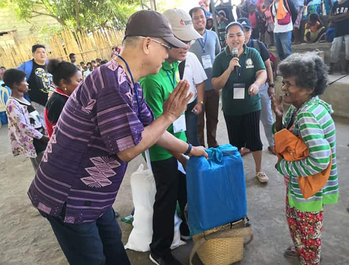 Manila Area Bishop Ciriaco Q. Francisco (left) and Jestril Alvarado, West Pampanga District superintendent, help distribute food to Aeta communities in Floridablanca in the Pampanga province of the Philippines. The United Methodist Committee on Relief issued a $100,000 grant to provide support for 860 indigenous families affected by a deadly earthquake. Photo by the Rev. Gilbert Cedillo.