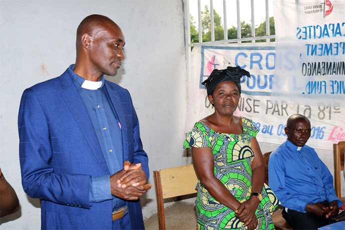 The Rev. Kabaiza Hatari, Fizi District superintendent, and his wife, Bukuru Hatari, encourage women who are taking classes at a new United Methodist-run vocational training center in Fizi, Congo. More than 100 women and 50 youth currently are receiving weekly training at the center. Photo by Philippe Kituka Lolonga, UM News.