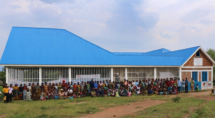 Women and youth pose for a photo after a training session at the new United Methodist-run vocational center in Fizi, Congo. The center offers literacy classes, as well as tailoring, cooking and soap-making instruction. Photo by Philippe Kituka Lolonga, UM News.
