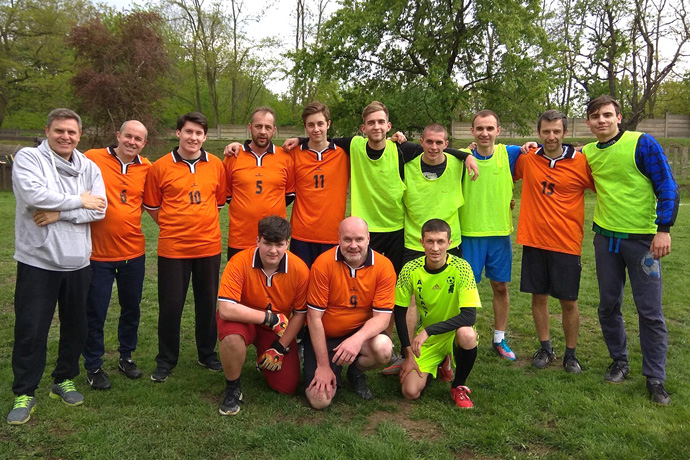The Rev. Lev Shults (left in grey), is a successful soccer coach in addition to being a pastor. Shults leads the Russian-speaking Agape United Methodist Church, among 23 local parishes of The United Methodist Church in Czechia. Photo by Urs Schweizer, Central Conference of Central and Southern Europe.
