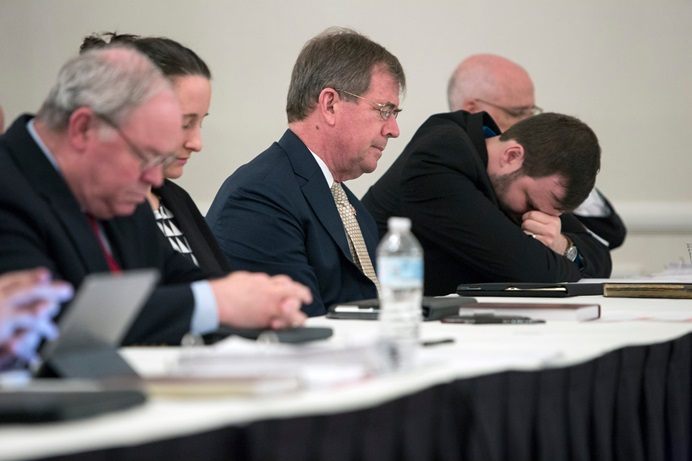 People who had submitted briefs to the United Methodist Judicial Council pray prior to a May 2018 oral hearing in Evanston, Ill. From left are the Rev. Keith Boyette, Stephanie Henry, Bishop Scott Jones, John Lomperis and Thomas E. Starnes. Boyette, Jones and Lomperis were among 28 United Methodists who signed a statement from a meeting in Atlanta about the formation of a new traditionalist denomination. File photo by Kathleen Barry, UM News.