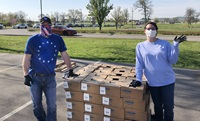 Over 30,000 pounds of food provided by Feed America First is distributed to those in need in Wilson County, Tenn. Lebanon First United Methodist Church in Lebanon, Tenn. was able to restock its food pantry as well as help provide a week's worth of food to over 350 families. Pictured are John Stephens and Laura Headley, members of Lebanon First United Methodist Church. Photo by the Rev. Ryan Bennett.